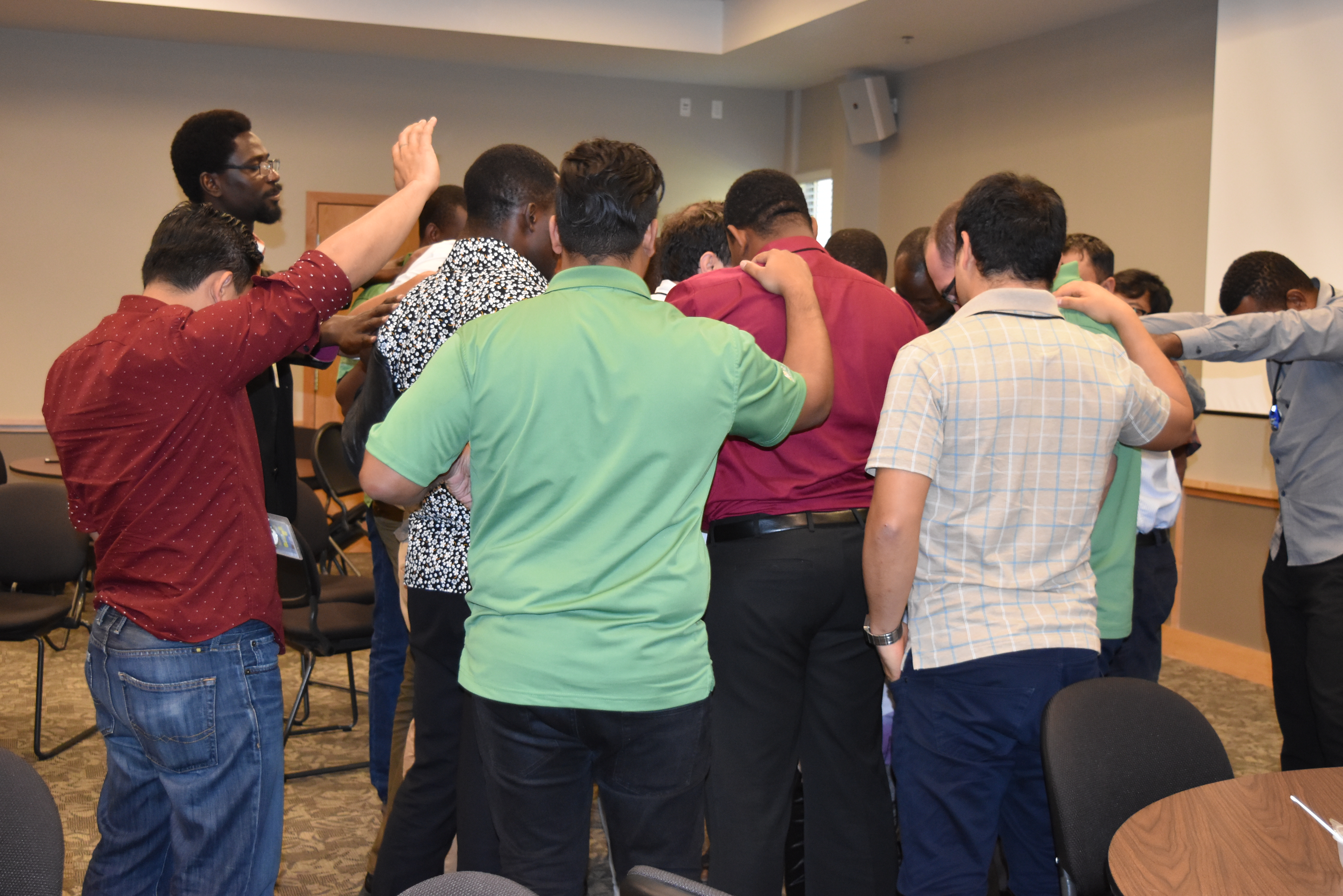 2018 Dallas GPA delegates praying