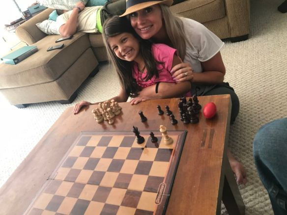 Emma and Chelsie playing chess